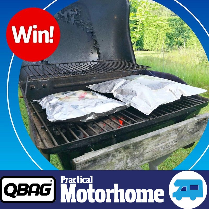 Photo of Two Qbags on a Barbecue with a WIN sign promoting the competition giveaway being run by Practical Motorhome Magazine in partnership with QBAG